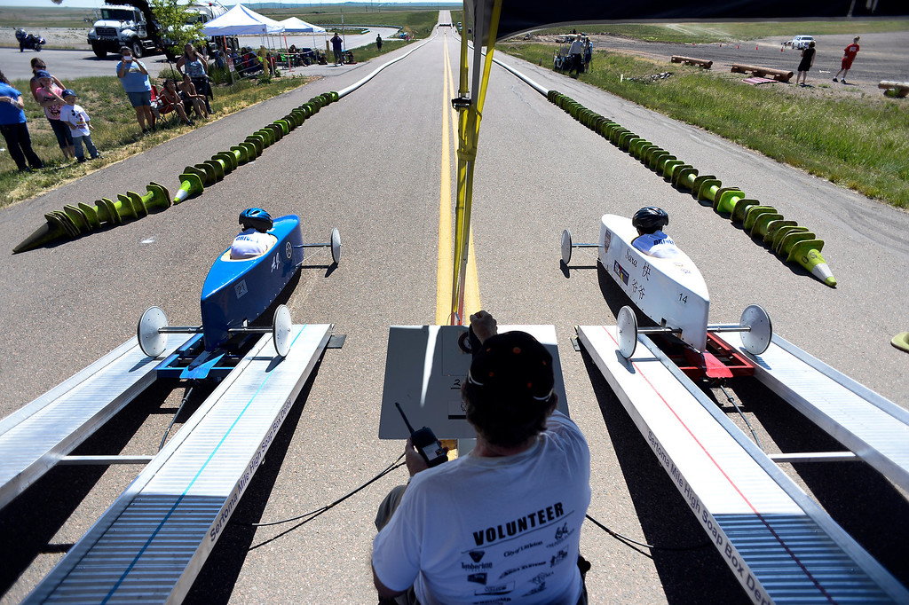. AJ Sippers, car #21, takes on Sara Stander car #14 during the Seventh Annual Sertoma Mile High Soap Box Derby June 9, 2013 in its first year at their new location at Arapahoe County Fair Grounds. The Sertoma Club, a non-profit international organization helps many of the estimated 50 million Americans with speech and hearing disorders. (Photo By John Leyba/The Denver Post)