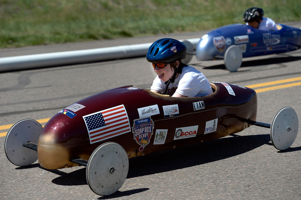 . Liam Cartwright in car #112 sticks his tongue out as he heads down the track during his race at the Seventh Annual Sertoma Mile High Soap Box Derby June 9, 2013 in their first year at their new location at Arapahoe County Fair Grounds. The Sertoma Club, a non-profit international organization helps many of the estimated 50 million Americans with speech and hearing disorders. (Photo By John Leyba/The Denver Post)