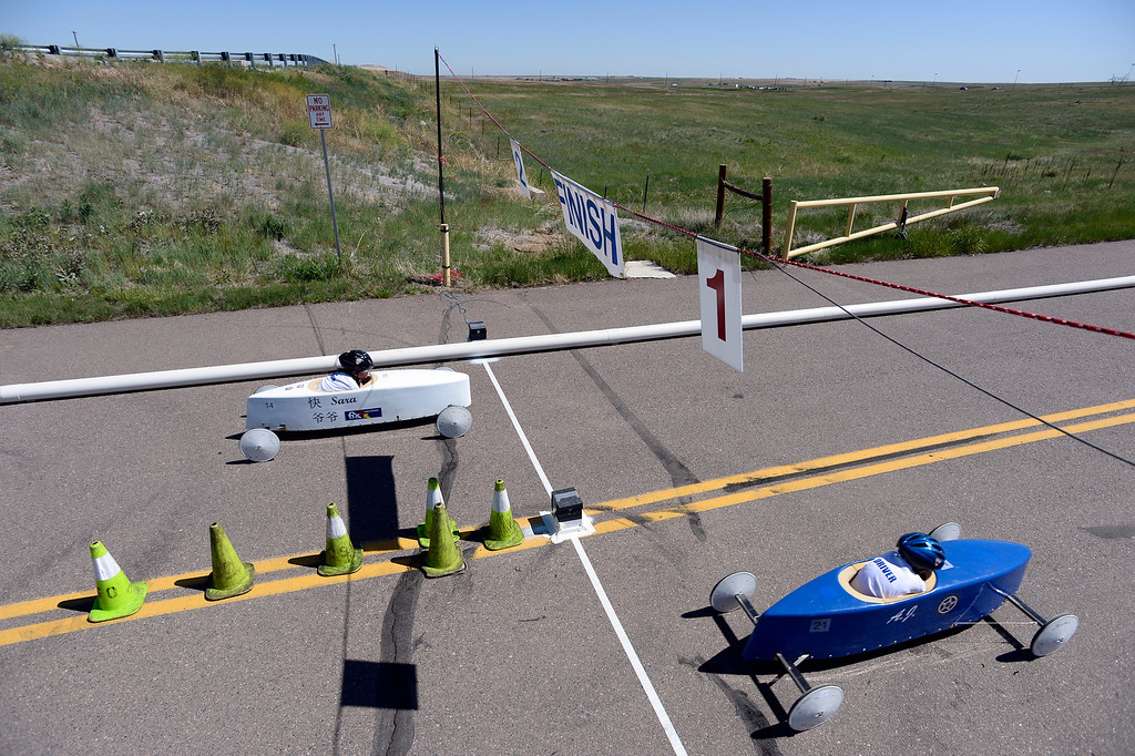 . AJ Sippers car #21 edges out Sara Stander car #14 at the finish line during the Seventh Annual Sertoma Mile High Soap Box Derby June 9, 2013 in its first year at their new location at Arapahoe County Fair Grounds. The Sertoma Club, a non-profit international organization helps many of the estimated 50 million Americans with speech and hearing disorders. (Photo By John Leyba/The Denver Post)