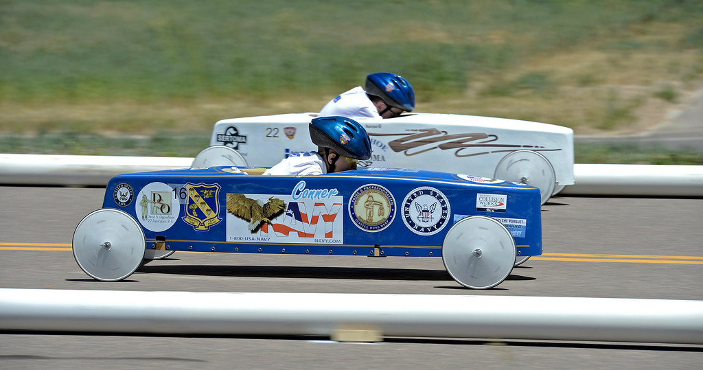 . Conner Stander car #16 takes on Aaron Grument car #22 during their race at the Seventh Annual Sertoma Mile High Soap Box Derby June 9, 2013. The Sertoma Club, a non-profit international organization helps many of the estimated 50 million Americans with speech and hearing disorders. (Photo By John Leyba/The Denver Post)