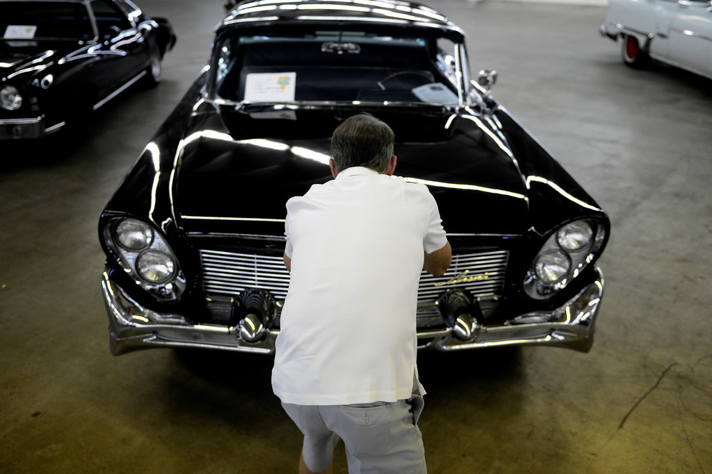 . Scott Parker takes a picture of an original 1958 Lincoln Capri during the Denver Modernism show on Sunday, August 25, 2013 at the Denver Coliseum. Spectators took in a car show as well as having the chance to shop at the exhibition hall where vendors had many mid-century items for sale. (Photo by AAron Ontiveroz/The Denver Post)