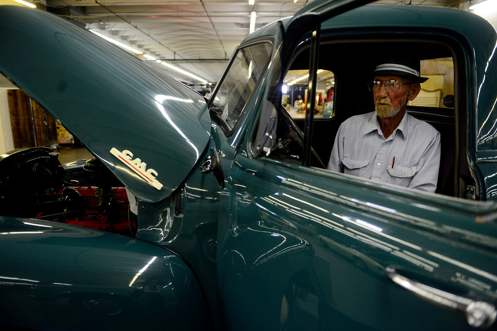 . Hubert Hill sits in his 1953 GMC 1/2 ton pickup during the Denver Modernism show on Sunday, August 25, 2013 at the Denver Coliseum. Spectators took in a car show as well as having the chance to shop at the exhibition hall where vendors had many mid-century items for sale. (Photo by AAron Ontiveroz/The Denver Post)