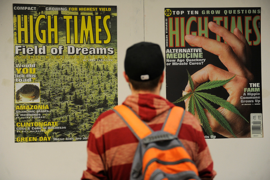 . Matt Knorr, 30, of Rochester, New York, checks out the display of High Times magazine covers during the High Times Cannabis Cup at Denver Mart in Denver, Colorado on April 20, 2014. Event organizers are expecting 37,000 people to attend the two day cup in Denver. (Photo by Seth McConnell/The Denver Post)