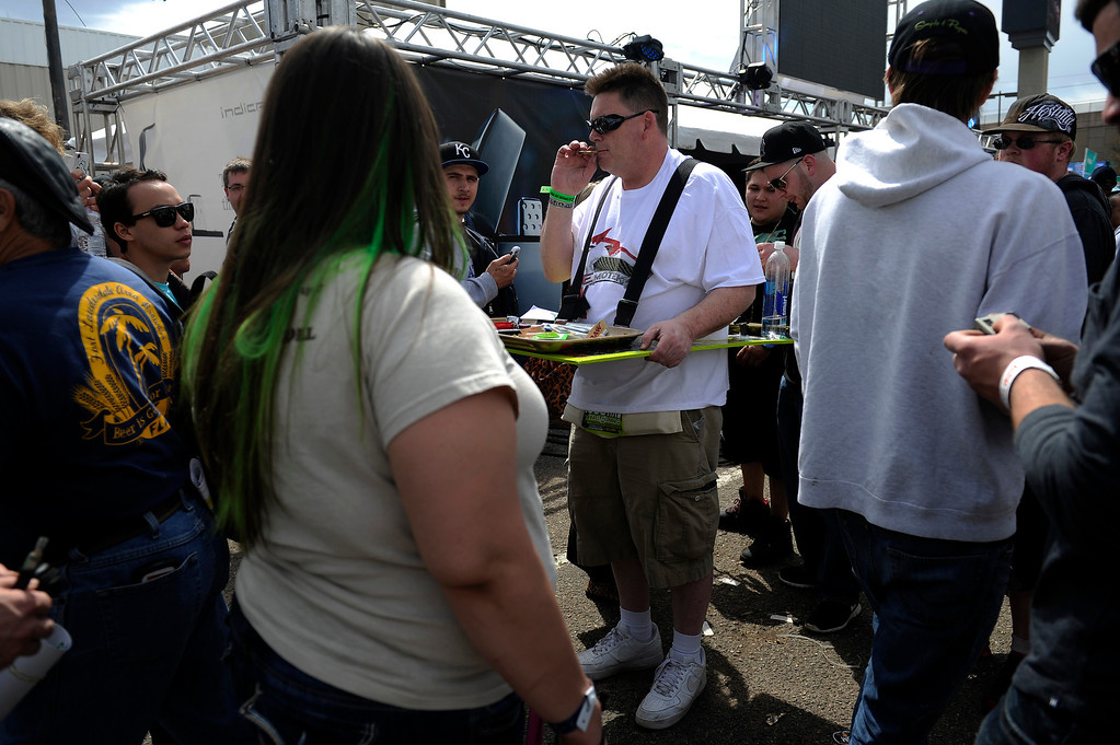 . Captain Kirk offers up a free mobile joint rolling table for patrons use during the High Times Cannabis Cup at Denver Mart in Denver, Colorado on April 19, 2014.  (Photo by Seth McConnell/The Denver Post)