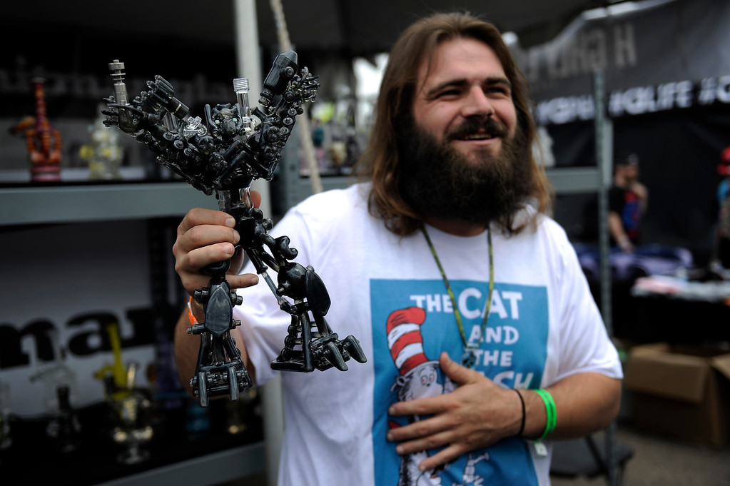. Kevin Chapman of Hitman Glass shows off a piece known as Iron Hide by Banjo during the High Times Cannabis Cup at Denver Mart in Denver, Colorado on April 19, 2014.  (Photo by Seth McConnell/The Denver Post)
