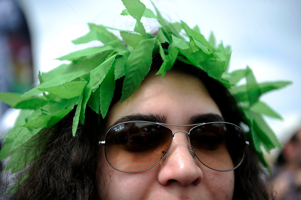 . Kristina Estrada, 26, of Springfield, Missouri, displays a marijuana headdress during the High Times Cannabis Cup at Denver Mart in Denver, Colorado on April 19, 2014.  (Photo by Seth McConnell/The Denver Post)