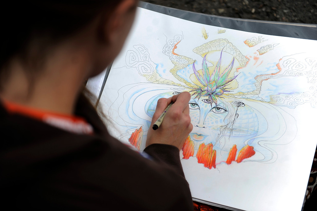 . An artist known as Delphi works on a piece during the High Times Cannabis Cup at Denver Mart in Denver, Colorado on April 19, 2014.  (Photo by Seth McConnell/The Denver Post)