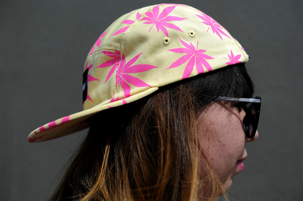 . Bianca Torres, 25, of Chicago, Illinois, wears a pot themed hat during the High Times Cannabis Cup at Denver Mart in Denver, Colorado on April 20, 2014. Event organizers are expecting 37,000 people to attend the two day cup in Denver. (Photo by Seth McConnell/The Denver Post)