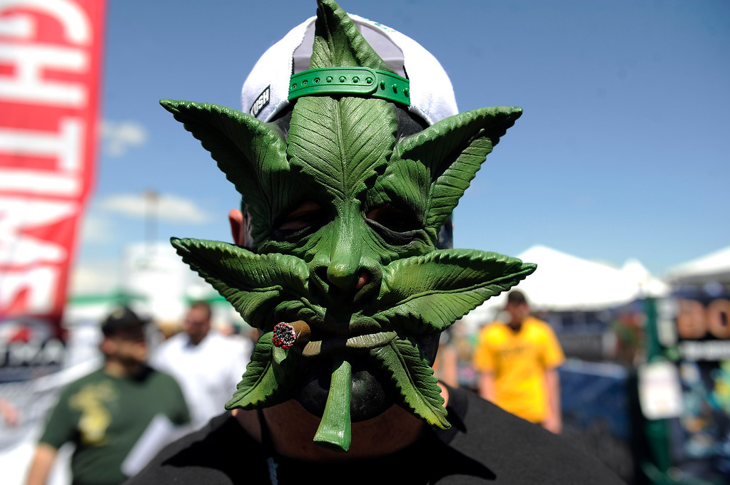 . Roger Decker displays a marijuana mask during the High Times Cannabis Cup at Denver Mart in Denver, Colorado on April 20, 2014. Event organizers are expecting 37,000 people to attend the two day cup in Denver. (Photo by Seth McConnell/The Denver Post)