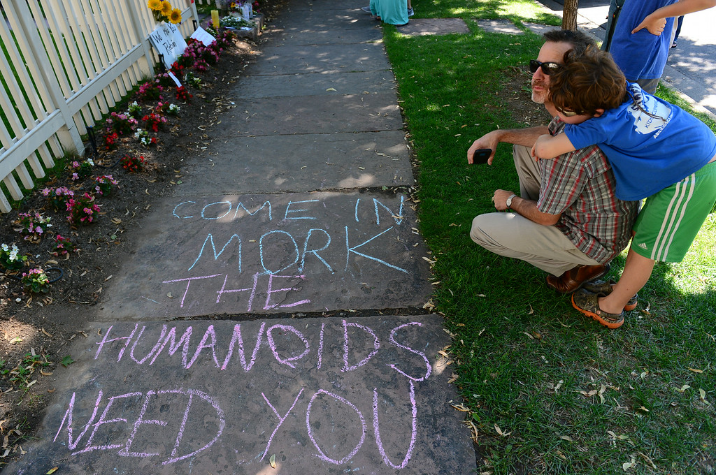 . Cameron Brooks and his son Malachi, 8, of Boulder, reflect for a moment in front of the Mork and Mindy house at 1619 Pine Street in Boulder, CO on August 12, 2014.  They, along with many others, turned out to pay their respects to Robin Williams who died of an apparent suicide at his home in California. The house was used as a setting for the 70\'s sitcom Mork and Mindy which helped launch the actor\'s career.   (Photo By Helen H. Richardson / The Denver Post)