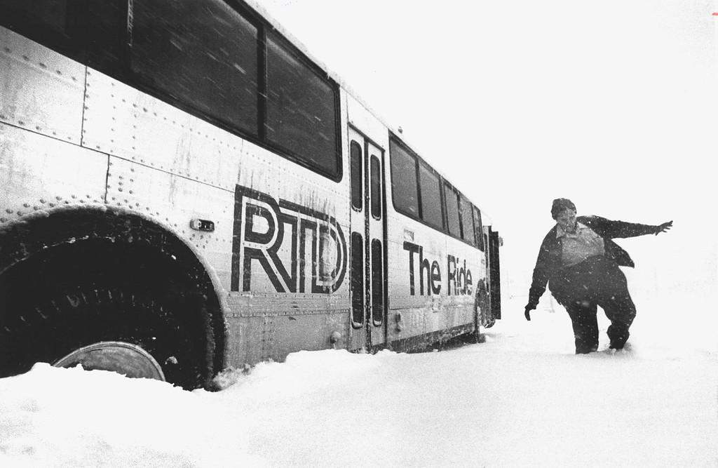 . DEC 1982, DEC 24 1982  Bus driver Doris Gray makes her way toward her buried tire at Sout I 14th during Fri. storm.  Credit: The Denver Post