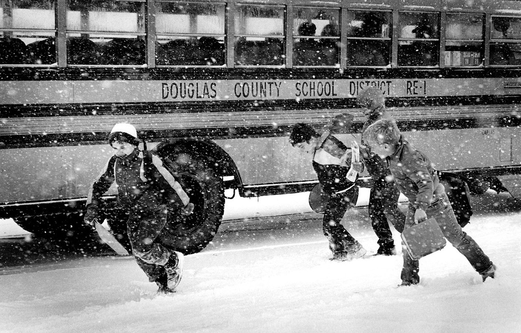 . 2/26/1987, FEB 27 1987  Because of the winter snow storm Douglas county school closed 1 1/2 hours early. here students from Pine Lane primary (6475 East Ponderosa) run for their buses at 2:30 pm.   Credit: The Denver Post