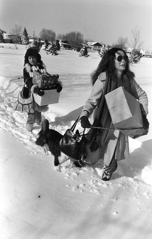 . DEC 25 1982, DEC 26 1982  Shirly Teston Cand Carol Desch had for the Bob Feys residence on Newport Way they are walking down Mexico on the south side of Cook park W/ presents  Credit: The Denver Post