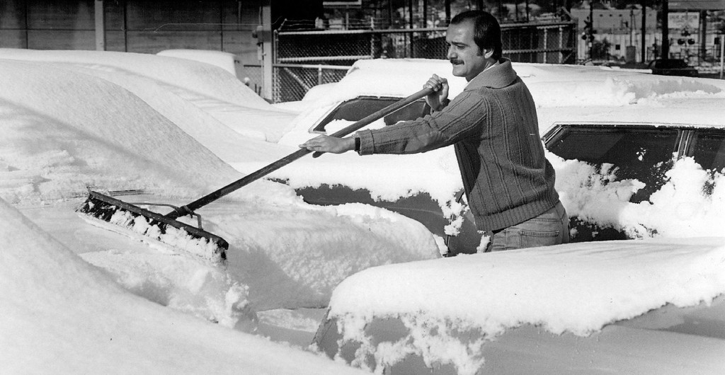 . OCT 20 1982  Brushing Off Nature\'s Work Mike Zitoli, a salesman for King Auto at 1101 S. Broadway, cleared snow from cars on the lot Tuesday morning. The storm caused power outages throughout the metropolitan area.  Mostly sunny skies and warmer temperatures  are forecast for today.  Credit: The Denver Post