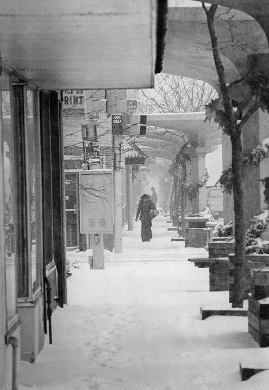 . JAN 22 1979, JAN 23 1979, JAN 24 1979  Littleton\'s Downtown Area Takes On A Blanket Of Beauty Large umbrellalike concrete structures frame the view of Main Street after Monday\'s snow storm. The storm left 3 inches of snow in the area and made roads icy and dangerous Monday evening. However, the forecast calls for continued clear skies through Wednesday across the state.  Credit: Denver Post