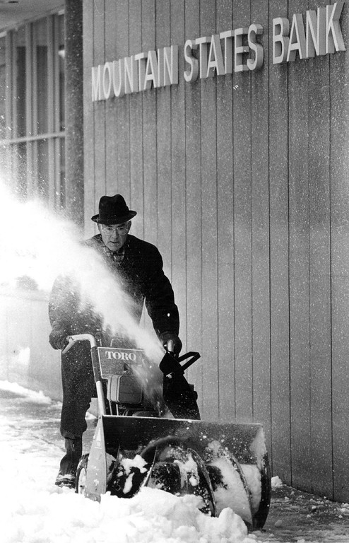 . DEC 1982, DEC 28 1982  Stoddard White puts in his time Monday morning behind a snow blower at Mountain states bank  Credit: The Denver Post