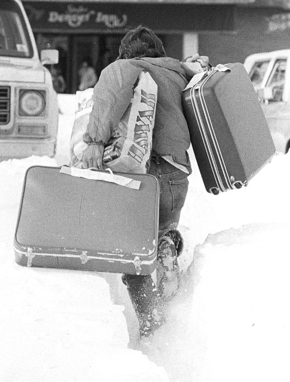 . DEC 1982, DEC 27 1982  Alan B. Huizenga of Golden Colo, makes his way through a snow drift near Stapleton as he awaits a friend who was most likely caught in the huge back-up of traffic. Alan was on vacation in Hawaii Dec. 17-24 and was held over in Honolulu Christmas eve and spent last might in Los Angeles with friends before he was able to get a flight back home today.  Credit: The Denver Post