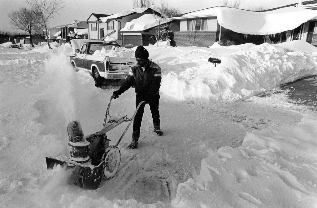 . 1-1983  Leland Williams,12945 47th, had plenty of snow in the driveway and street Tuesday as drifts from the blizzard display in the background Williams couldn\'t get to work from his Montbello home because of the high drifts and he plans to snowblow the entire street until he reaches an open road  Credit: The Denver Post