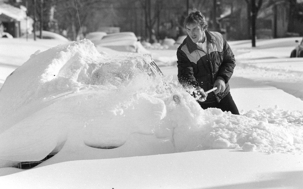 . 12-1982  Tim Van Zee, from North Dakota, visiting his sisters fro the holidays discovered his car completly covered. He planned to spend most of Christmas day digging out  Credit: The Denver Post