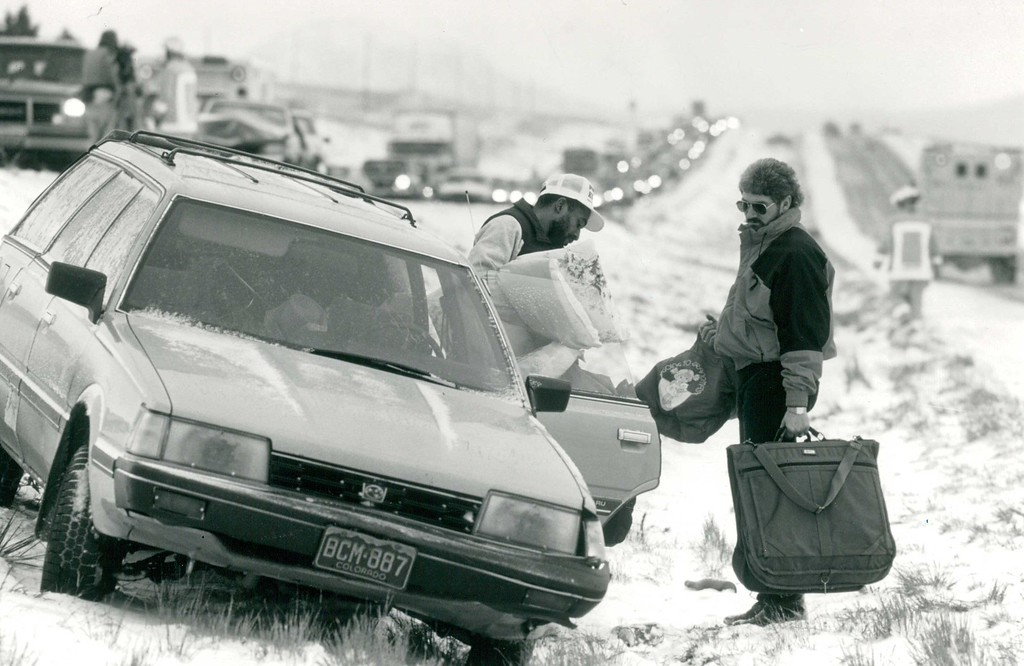 . FEB 25 1991  Peyton Earl Patterson of Denver (right) helps Tracy Smith of Denver unload smith\'s car after they were involved in one of several multi car accidents on I-25 in the vicinty of Monument Hill Sunday during a snow storm. This multi-car collisiion backed traffic up in the north bound lane for three miles.  Credit: The Denver Post