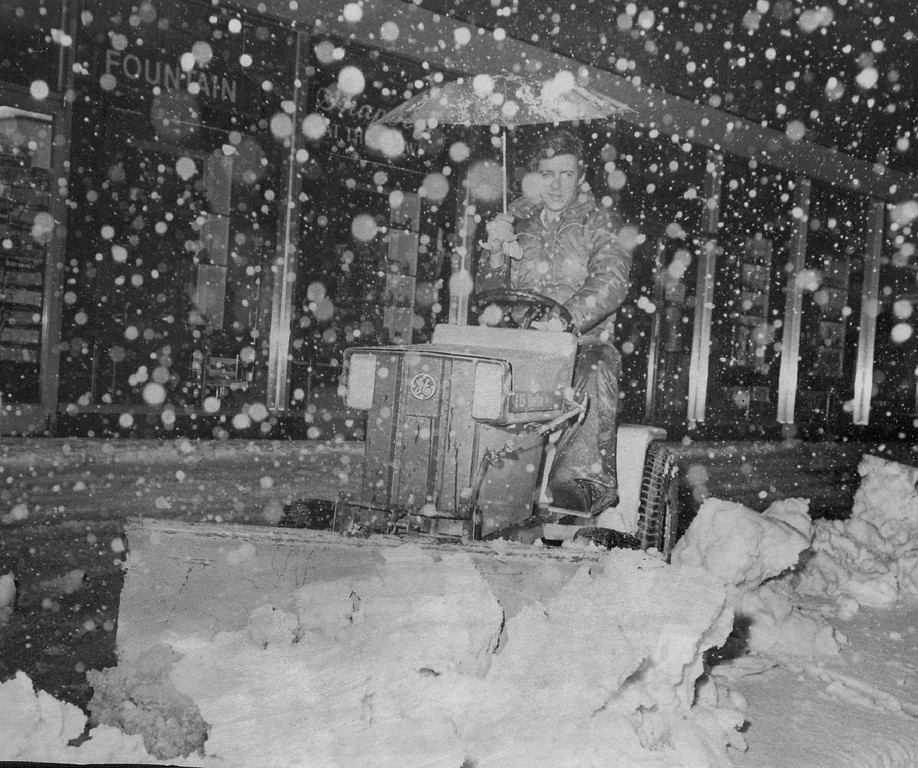 . MAR 4 1981, MAR 6 1981  Umbrella Wasn\'t Made for Blizzard Brown Palace Hotel employee Ernest McCarther, protected by umbrella, blasts through the snow piled on a downtown Denver sidewalk in front of the Brown Palace with an electric snow remover early Wednesday morning as the wind blew and the flakes swirled around him. The biggest storm of the season snarled traffic, caused accidents and power outages and was accompanied by winds that formed large drifts.  Credit: Denver Post