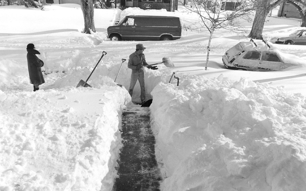 . 12-1982  Brice Olson, visiting relatives in Denver from Minnetonka, Minn, offered his help to a neighbor. Being from Minnestota, Olson sad he had seen plenty of snow over the years but the Denver storm was probably the worst he had seen in sometime.  Credit: The Denver Post