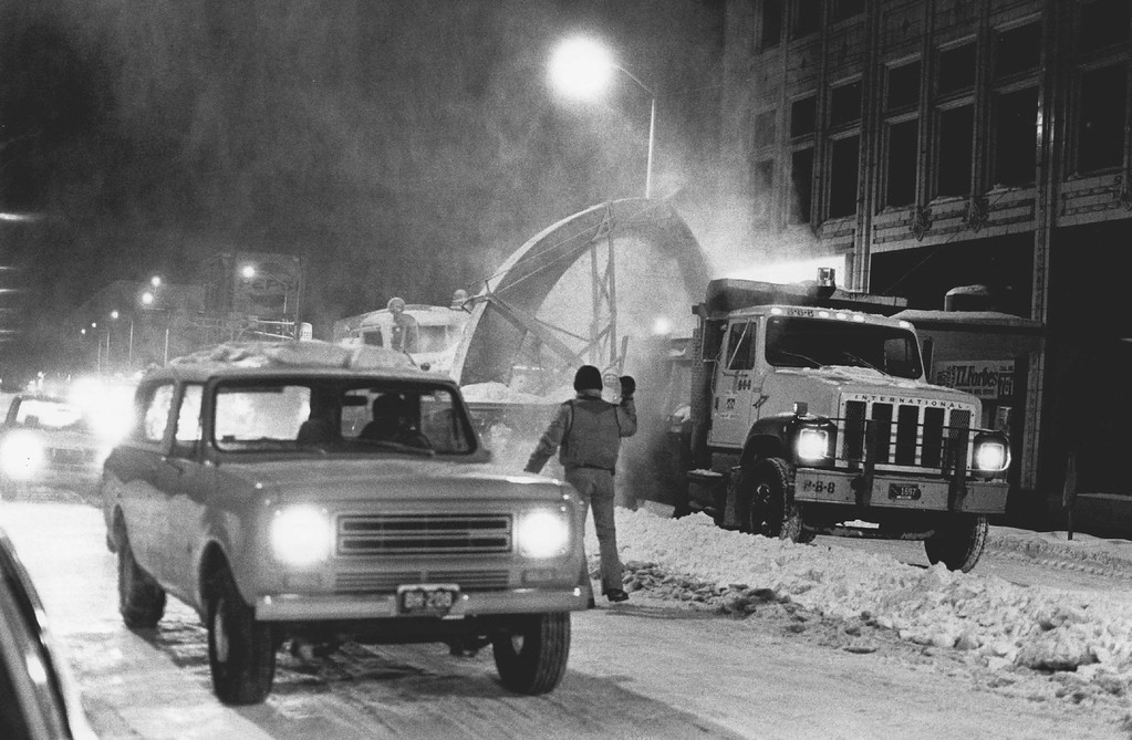 . DEC 1982  12-28-82 - 10 p.m. - Snow plows digging out the city of Denver between 15th & 16th & stout  Credit: The Denver Post