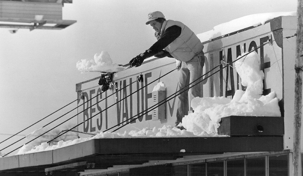 . DEC 27 1982, DEC 28 1982  Jeff Mace, an employee at Best Value Appliances, 7501 E. Colfax took a load off the business\' roof.  Credit: The Denver Post