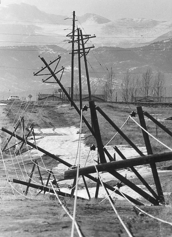 . MAR 15 1977  Storm Damage These toppled utility poles at Arapahoe Road and Dry Creek were blown over during the blizzard which closed schools, interstate highways and claimed several lives in eastern Colorado last week. The damage to the poles caused a blacked in the area during the major storm that began last Thursday.  Credit: Denver Post.