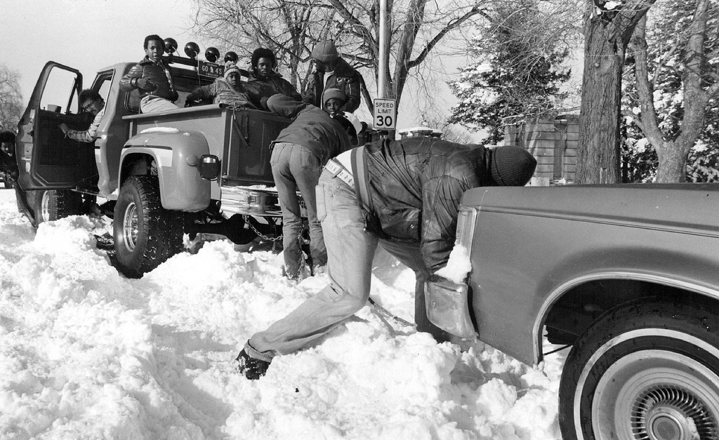 . DEC 25 1982, DEC 26 1982  Mike Williams, driver of this four-wheeled drive truck helped several stranded motorists on East Colfax near East High school. Even with his special equipment, Williams got stuck attempting to help the others  Credit: The Denver Post