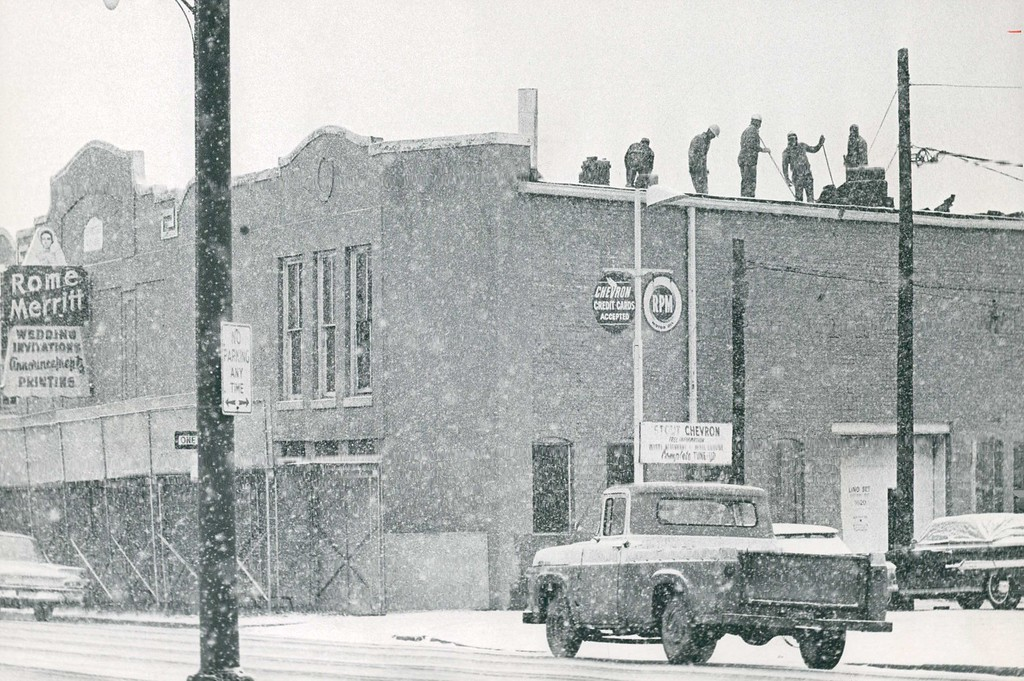 . DEC 23 1965  Demolition Starts Convention Center Workmen are on the roof of a building at 1650 Speer Blvd. to begin demolition, the first step in eventual construction of Denver\'s Community and Convention Center. The demolition began Thursday morning-in a snow storm. B & L Wrecking Co. was awarded a contract for $3,560 to remove the structure, purchased by the city for $27,621. The Community and Convention Center, for which voters approved bonds in June 1964, will be located between 14th St. and Speer Blvd. and Stout and Champa Sts. Voters approved issuance of $11,450,000 in bonds for construction of building.  Credit: Denver Post