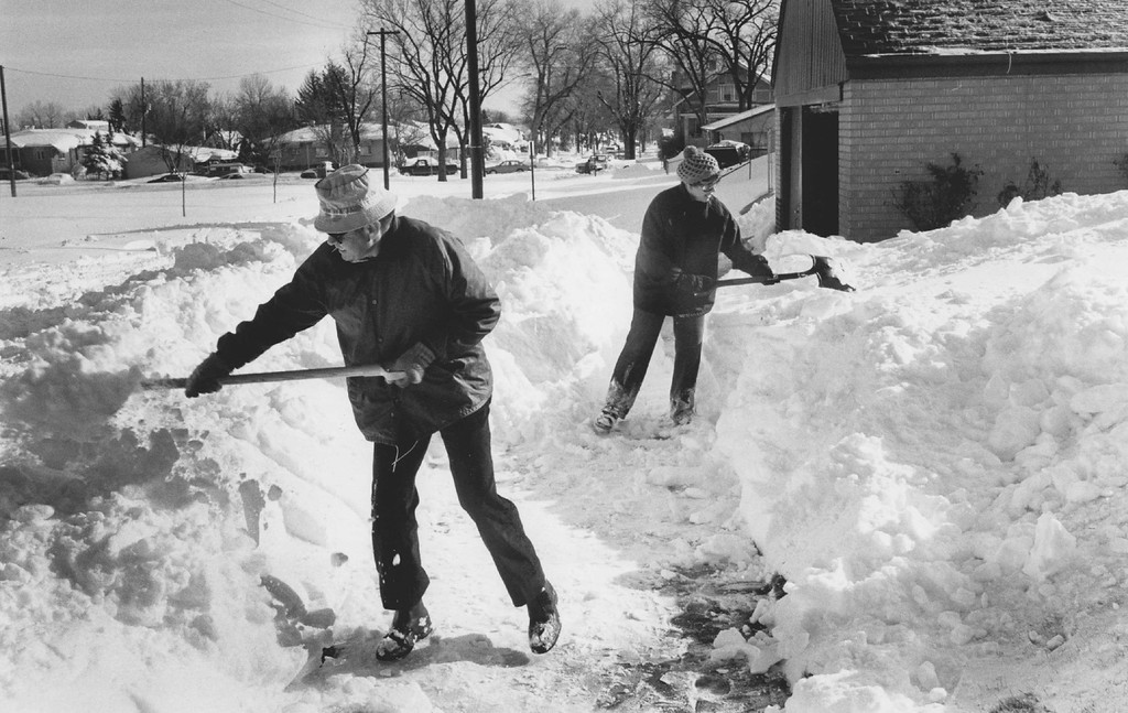 . DEC 1982, OCT 26 1997  Terri Schneider right and Dick Sanchez are digging out at 3456 north Federal. Dick is a Tennant there  Credit: The Denver Post