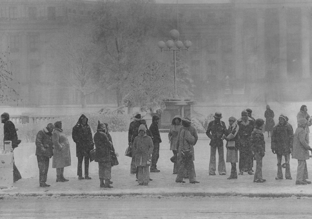 . NOV 8 1977  Waiting Along Broadway For a Bus Tuesday Morning was a cool experience The Storm began as gentle rain, then turned to snow at 3:45a.m. in Denver. It reached near - blizzard proportions by Sunrise.  Credit: Denver Post
