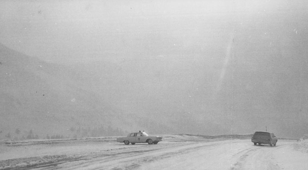 . 2-1-1968  Patrol car checks car in top of Loveland wind & ground blizzard.  Credit: Denver Post