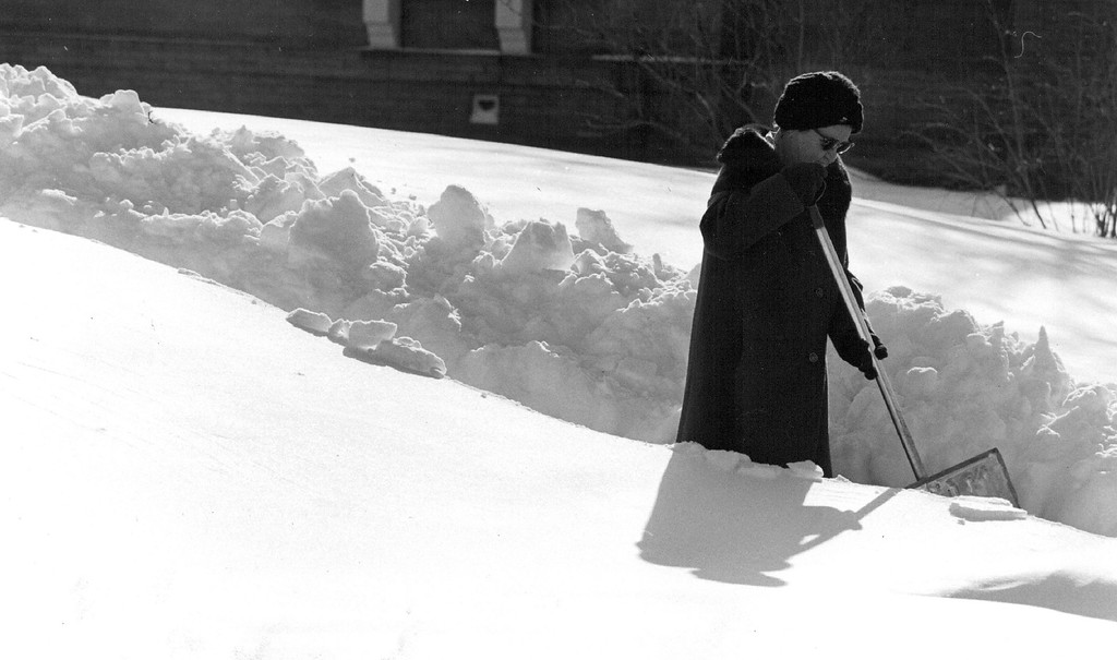 . 12-1982  Mrs. Murray Martin cuts her swath along the family sidewalk from their front door step.  Credit: The Denver Post