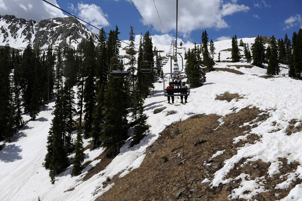 . SUMMIT COUNTY, CO - JUNE 08: Skiers riding the Lenawee Mountain Lift at the Arapahoe Basin ski area in Summit County Colorado, Saturday morning, June 08, 2013. The ski area will close for the season at the end of the day, Sunday June 09, 2013.  (Photo By Andy Cross/The Denver Post)