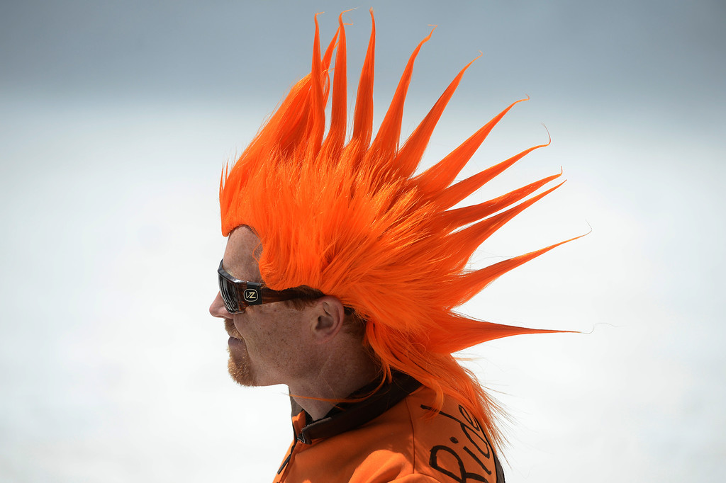 . SUMMIT COUNTY, CO - JUNE 08: Snowboarder, Ryan Laird, from Ft. Collins Colorado, sports a orange mohawk wig at the Arapahoe Basin ski area in Summit County Colorado, Saturday morning, June 08, 2013. The ski area will close for the season at the end of the day, Sunday June 09, 2013.  (Photo By Andy Cross/The Denver Post)