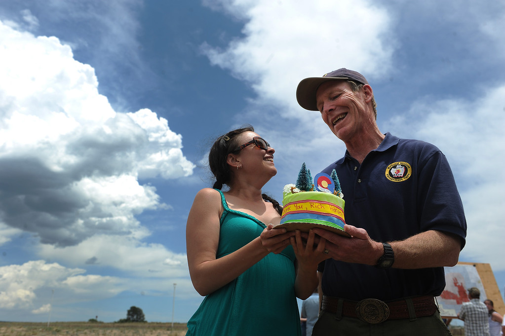 """. BLACK FOREST, CO - JUNE 16: Colorado Springs resident Nikki Connon, left, backed a cake to say thank you to Incident Commander Rich Harvey after the press briefing at the Pikes Peak Community College Rampart Range Campus near Monument, Co on June 16, 2013.  Connon had been evacuated last year on the Waldo Canyon fire and described Rich Harvey as a \""""fire genius.\"""" Photo by Helen H. Richardson/The Denver Post)"""