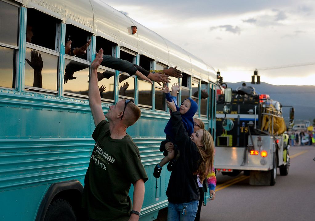 . Hundreds of Colorado Springs and area residents turned out at the corner of Old Ranch Road and Thunder Mountain Road outside of the Black Forest Fire Incident Command Post to cheer on firefighters and law enforcement officials as they come off of the fire line for the evening on June 16, 2013. The command post is set up at Pine Creek High School. The fire is currently 65% contained.  Photo by Helen H. Richardson/The Denver Post)