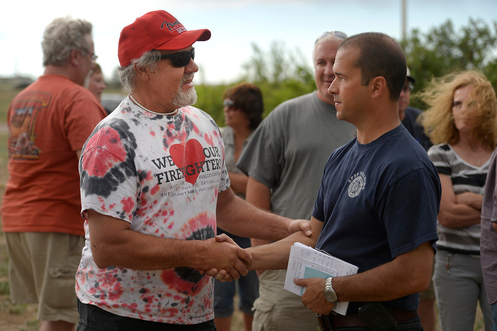 . BLACK FOREST, CO - JUNE 16: Colorado Springs resident Danny Pitcher shakes the hand of El Paso County Sheriff Terry Maketa  after the daily press briefing for the media at Pikes Peak Community College Rampart Range Campus near Monument, CO  on June 16, 2013. Maketa took the time after the press briefing to meet personally and privately with homeowners to address all and any questions they might have had. Photo by Helen H. Richardson/The Denver Post)