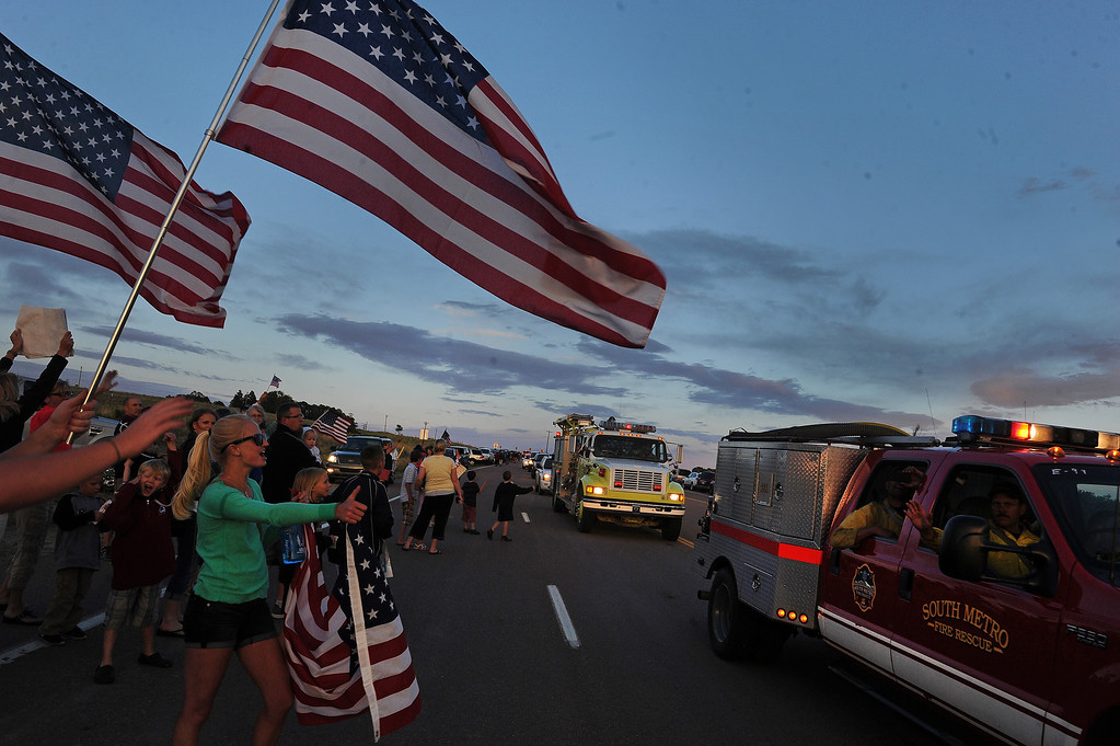 . BLACK FOREST, CO - JUNE 16:  Hundreds of Colorado Springs and area residents turned out at the corner of Old Ranch Road and Thunder Mountain Road outside of the Black Forest Fire Incident Command Post to cheer on firefighters and law enforcement officials as they come off of the fire line for the evening on June 16, 2013. The command post is set up at Pine Creek High School. The fire is currently 65% contained.  Photo by Helen H. Richardson/The Denver Post)