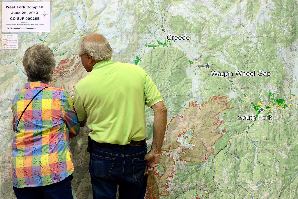 . CREEDE, CO - JUNE 25: Beverly and Gary Moore look at the burn map during a Creede community meeting as the Papoose fire continues to burn near the small town. The three fires that make up the West Fork Complex fire now top out at more than 70 thousand acres. (Photo by AAron Ontiveroz/The Denver Post)