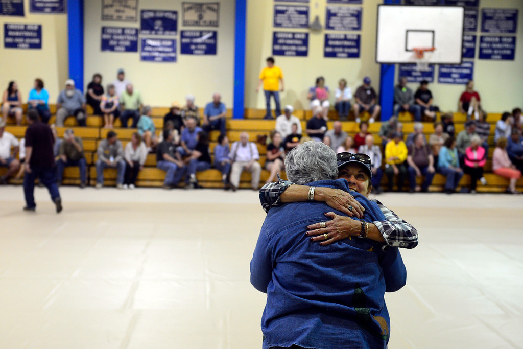 . CREEDE, CO - JUNE 25: Possum Steinbach (facing camera) hugs Gloria Mayes as they greet each other at a Creede community meeting as the Papoose fire continues to burn near the small town. The three fires that make up the West Fork Complex fire now top out at more than 70 thousand acres. (Photo by AAron Ontiveroz/The Denver Post)