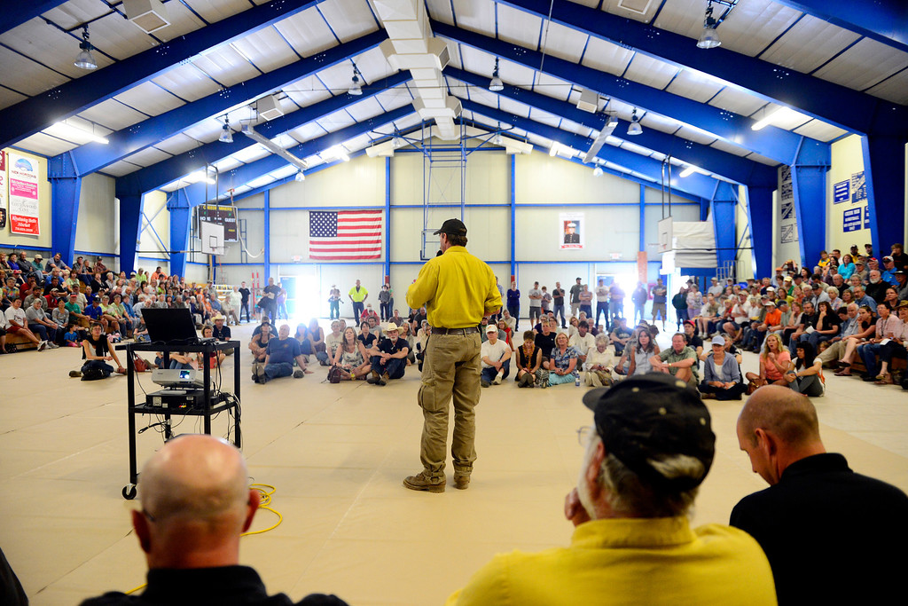 . CREEDE, CO - JUNE 25: Residents listen to officials speak during a Creede community meeting as the Papoose fire continues to burn near the small town. The three fires that make up the West Fork Complex fire now top out at more than 70 thousand acres. (Photo by AAron Ontiveroz/The Denver Post)