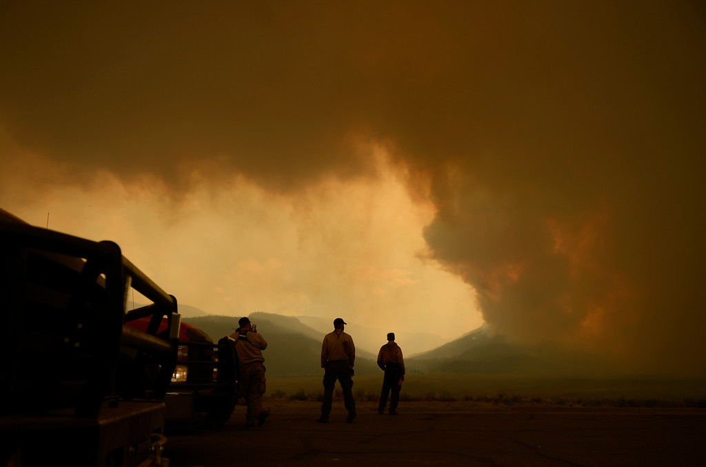 . CREEDE, CO-June 25, 2013: Firefighters battling the West Fork Complex Fire watch as the wildfire in southwestern Colorado continues to grow, June 25, 2013. (Photo By RJ Sangosti/The Denver Post)