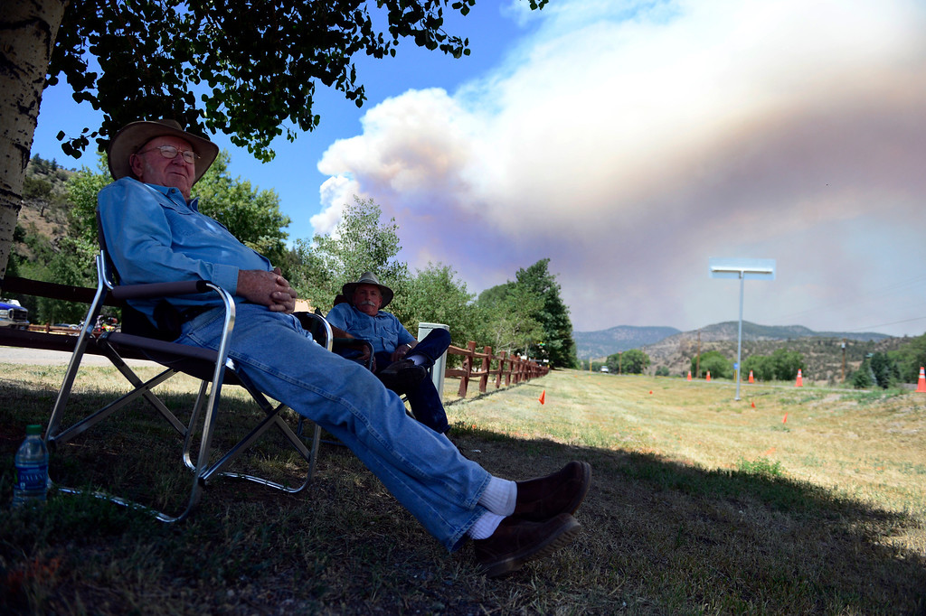 . Don Smith and Ralph Harden sit near the Highway 160 roadblock, while watching the action as the West Fork Fire continues to burn near South Fork. The West Fork Fire grew to more than 70,000 acres overnight. (Photo by AAron Ontiveroz/The Denver Post)