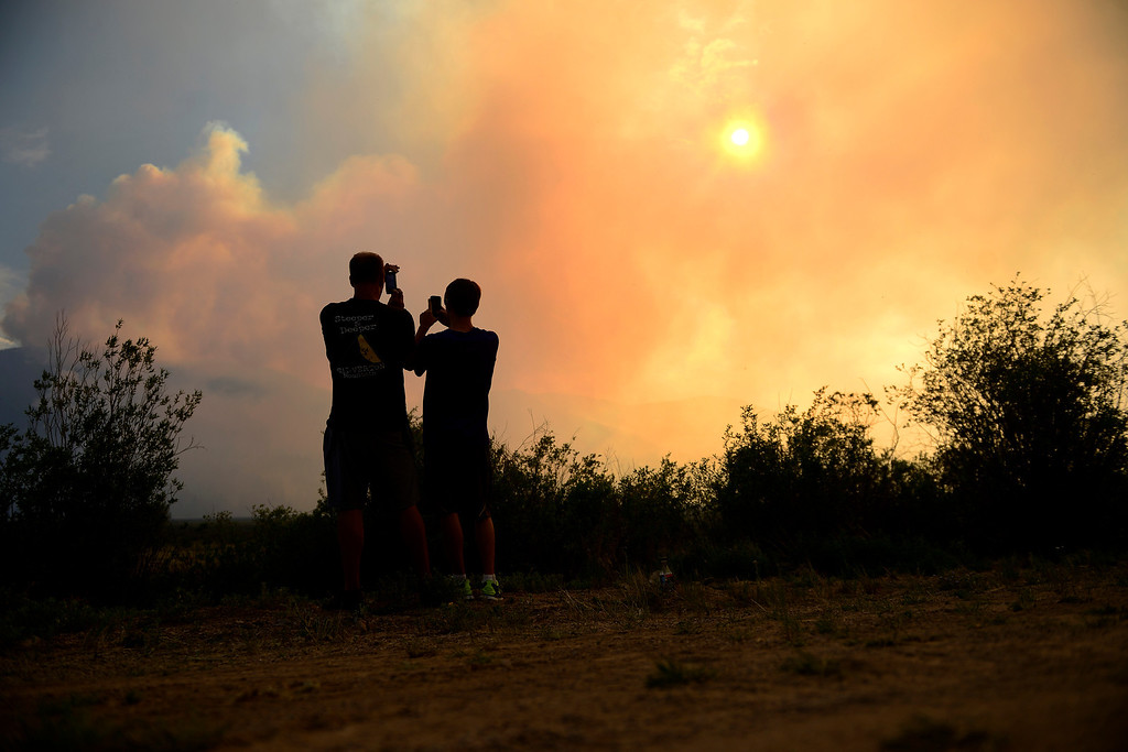 . Ben Hake (left) and Ryan Scroggins photograph as the West Fork Fire continues to burn near Creede. The West Fork Fire grew to more than 70,000 acres overnight. (Photo by AAron Ontiveroz/The Denver Post)