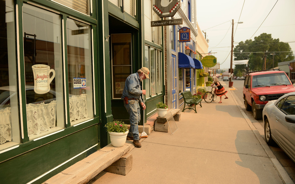 . Buck Sneed, cleans up outside his wife\'s cafe, Cafe Ole in Creede, June 26, 2013. The cafe closed early because of a lack of customers due to the wildfires keeping summer tourists away. (Photo By RJ Sangosti/The Denver Post)