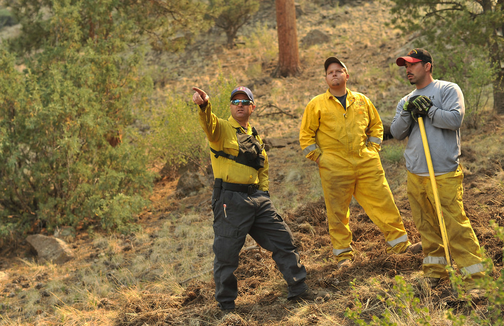 . From left, Brad Egger of Los Pinos Fire Department, Mark Sowards and Michael Abeyta from South Conejos fire department are checking the direction of wind and smoke of the West Fork Complex fire at Masonic Park in South Fork on Saturday, June 22, 2013. (Photo By Hyoung Chang/The Denver Post)