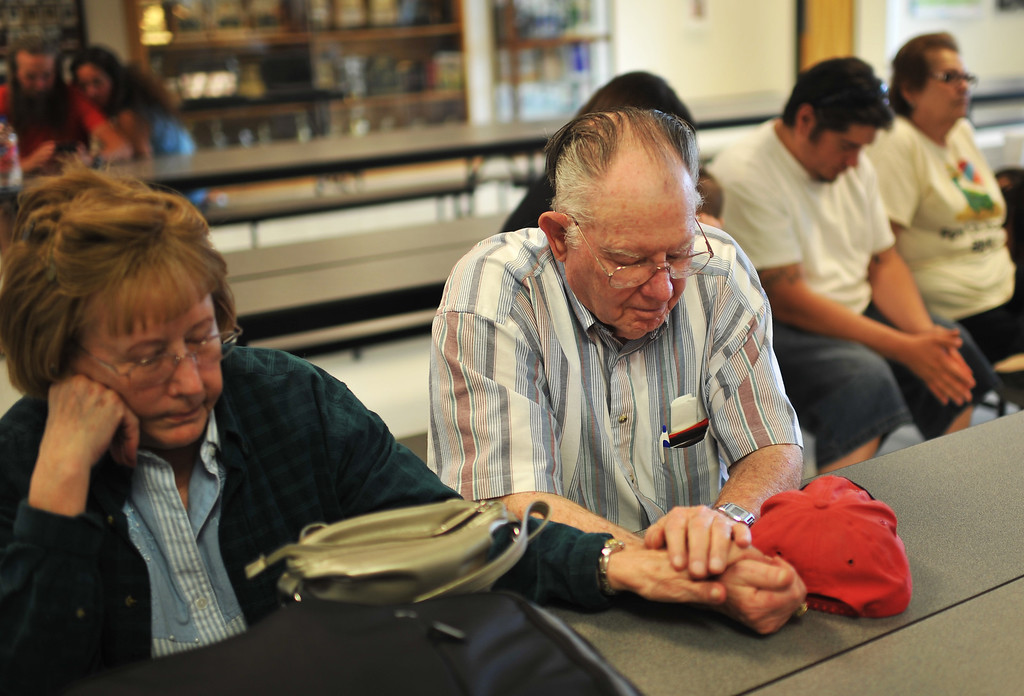 . West Fork Complex fire evacuee Joan Thomas, left, and her husband Gerald are praying for the firefighters at Del Norte High School Gym on Friday, June 21, 2013. (Photo By Hyoung Chang/The Denver Post)